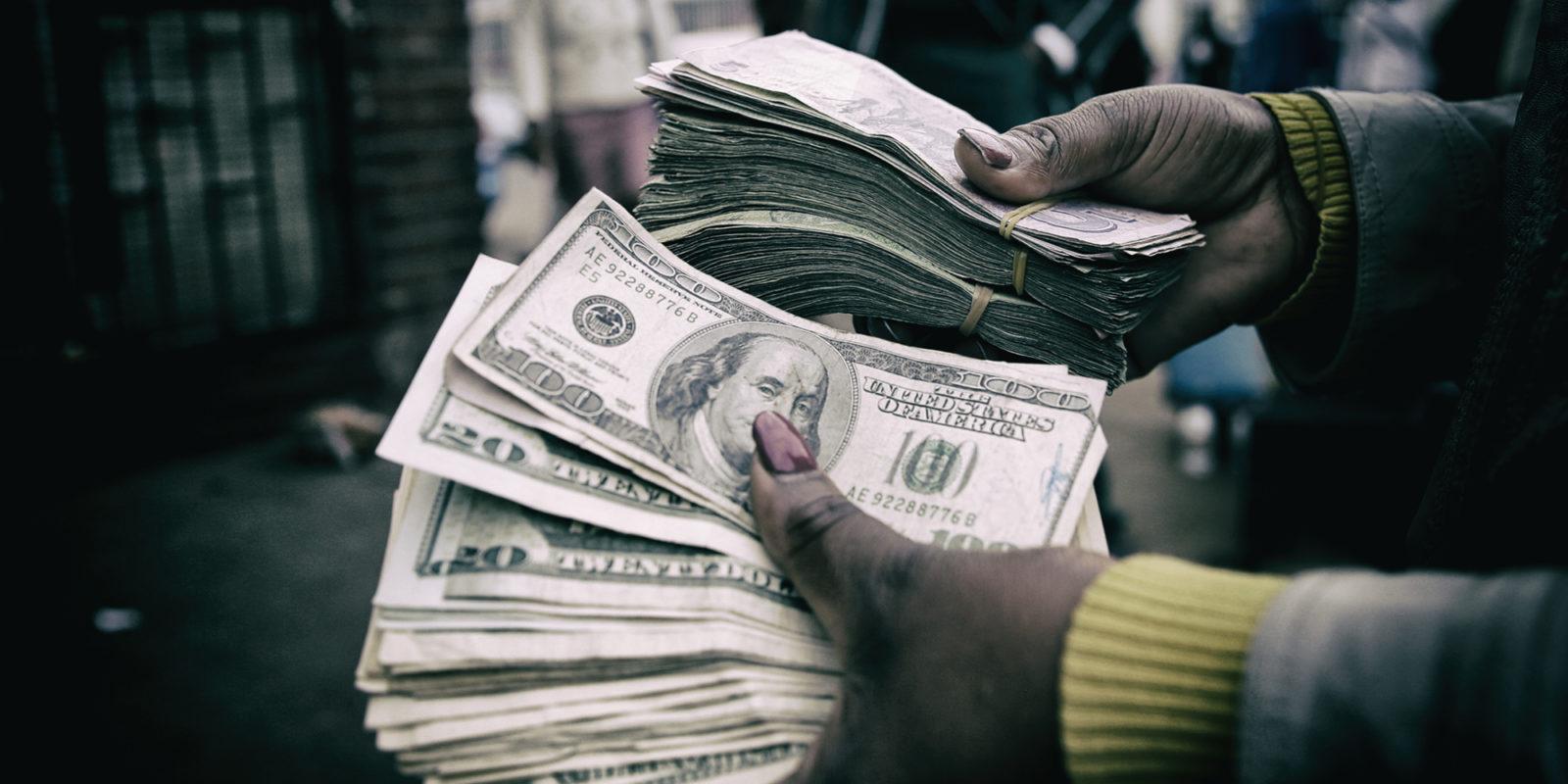 Zimbabwe Brings Back Us Dollar Peg For