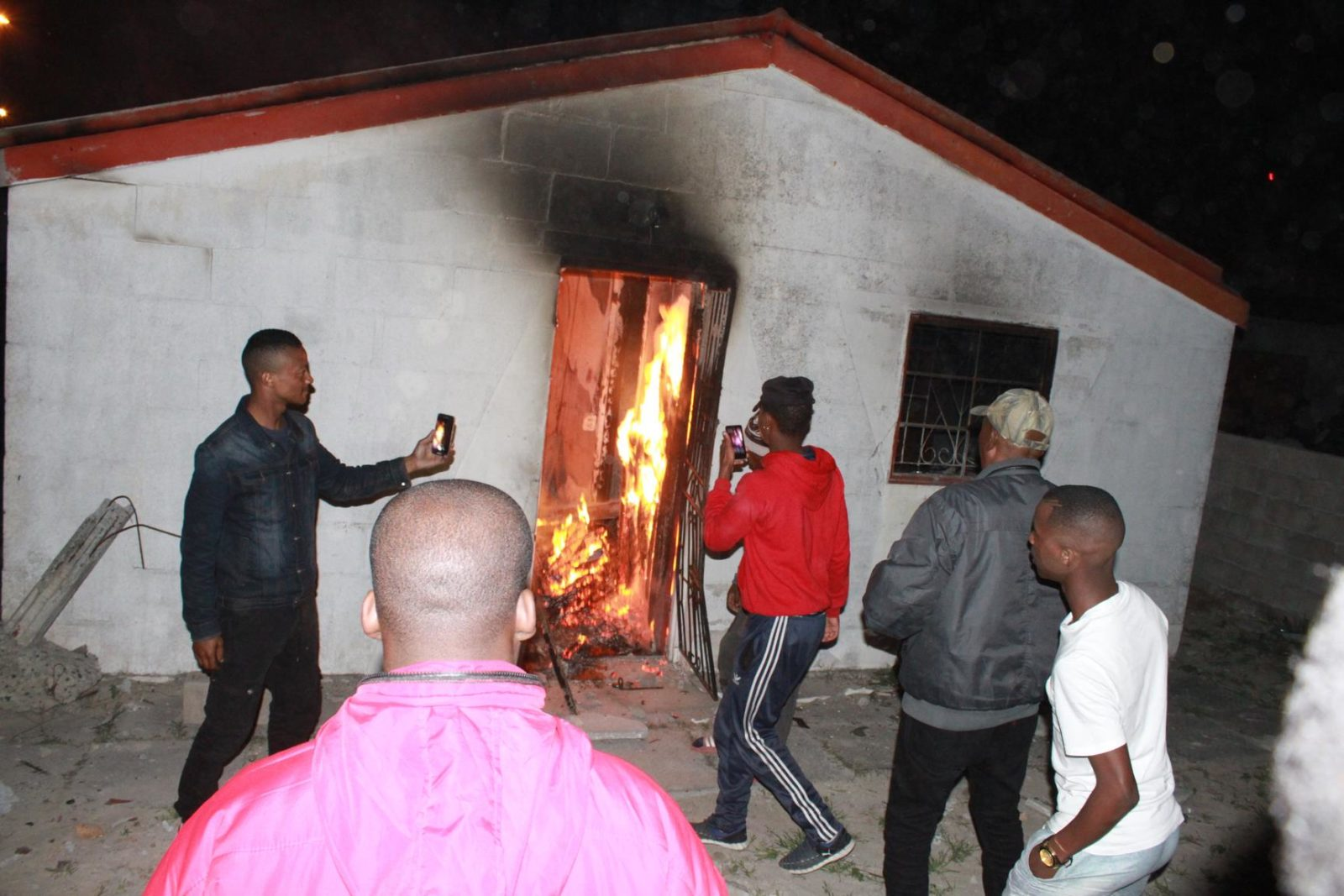 Khayelitsha residents torch house and dig 'grave' f