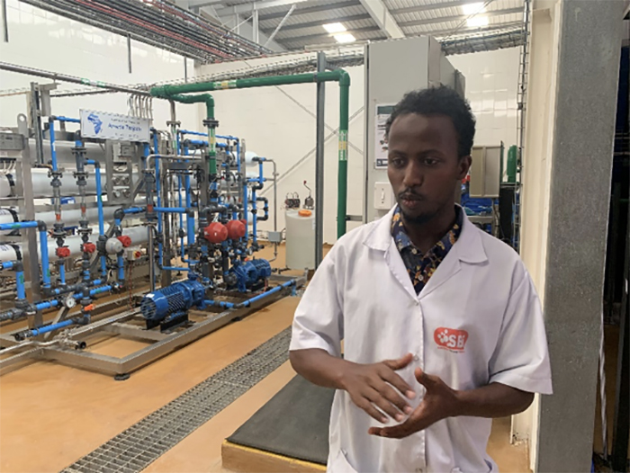 Production team leader at the Coke plant, Abdi Fattah Ibrahim, started out as a worker on the machine line.