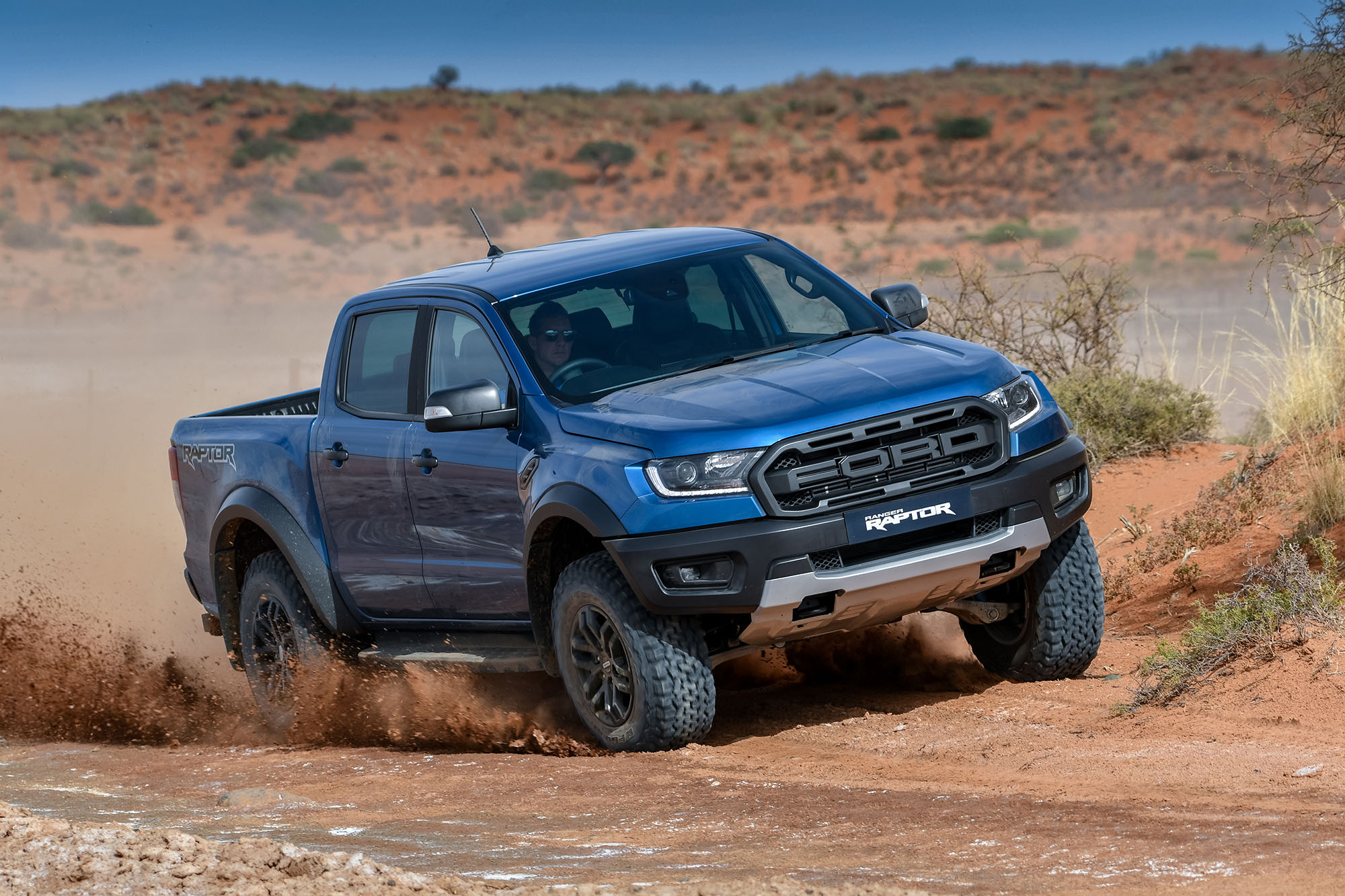 while the ranger s leaf springs have made way for an independent multilink rear suspension the tracks are 15cm wider and the raptor