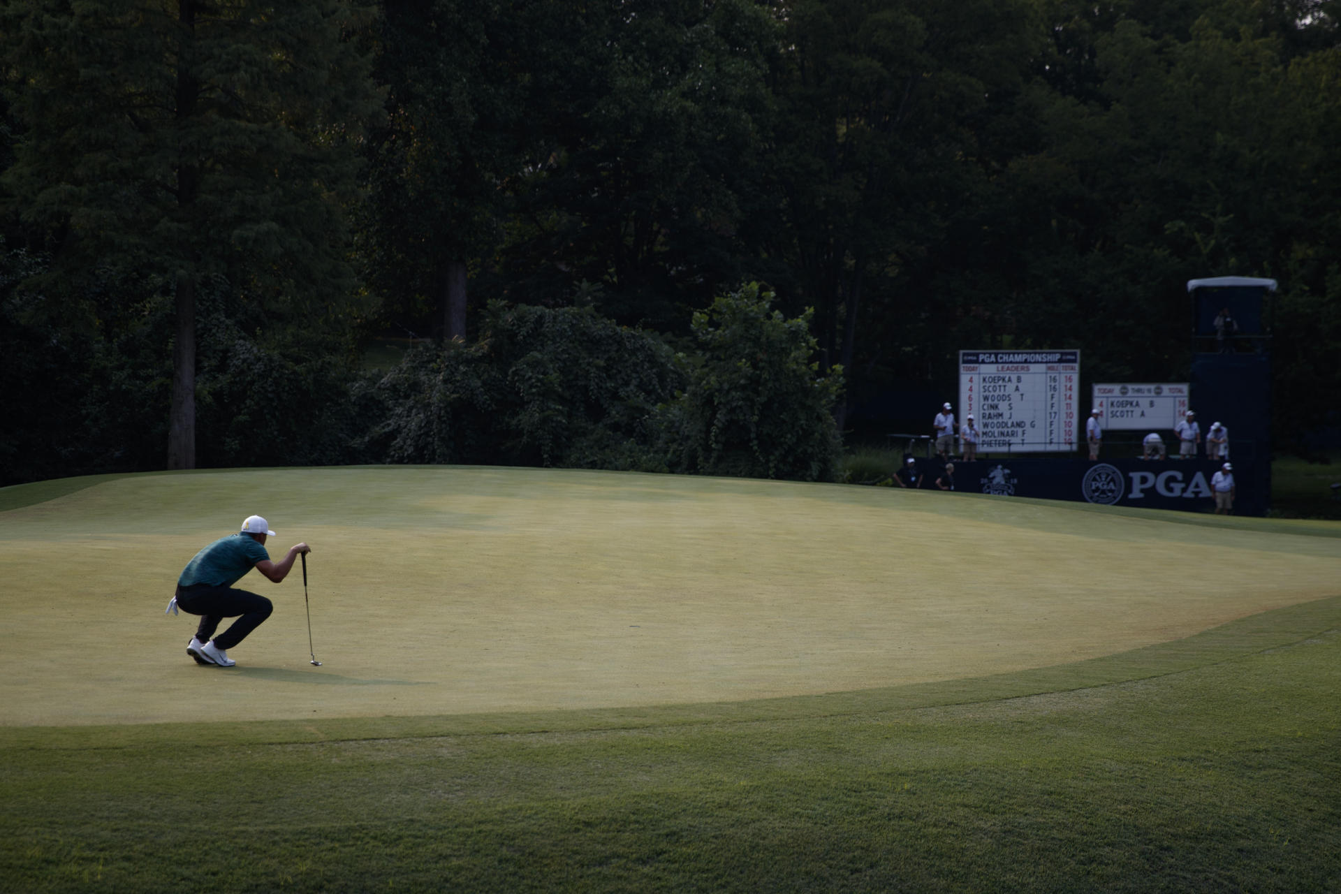 Koepka holds off Woods to win 100th PGA Championship ...