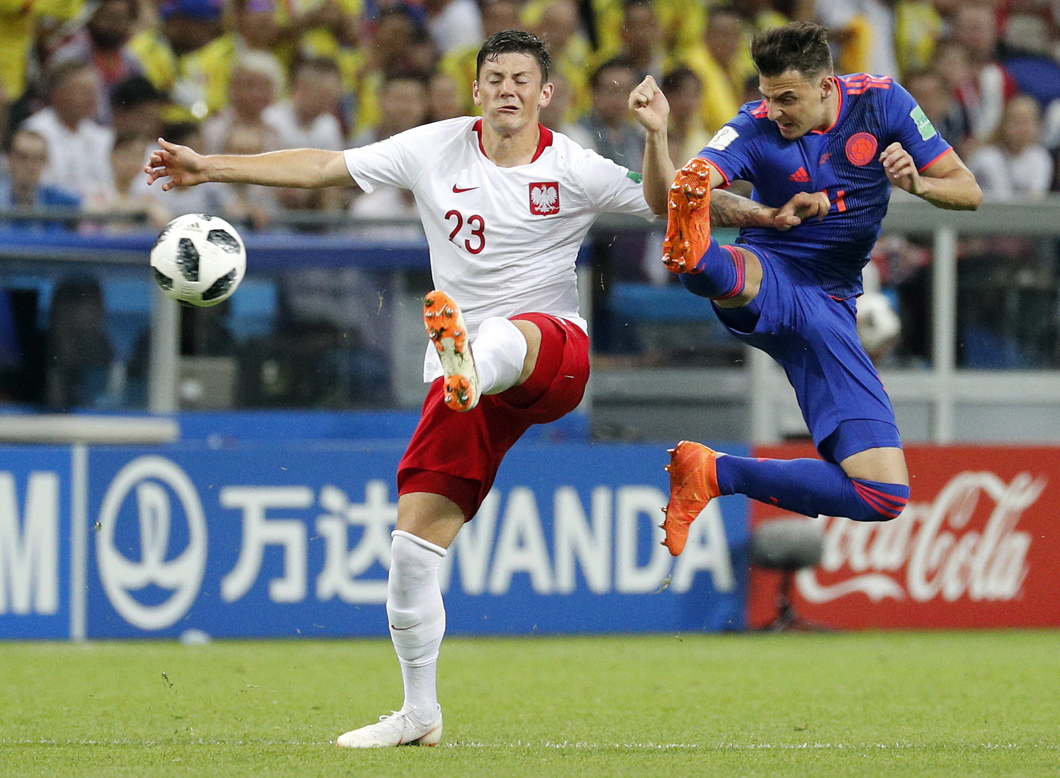 8dafdd576fe ... Colombia (R) and Dawid Kownacki of Poland in action the FIFA World Cup  2018 group H preliminary round soccer match between Poland and Colombia in  Kazan