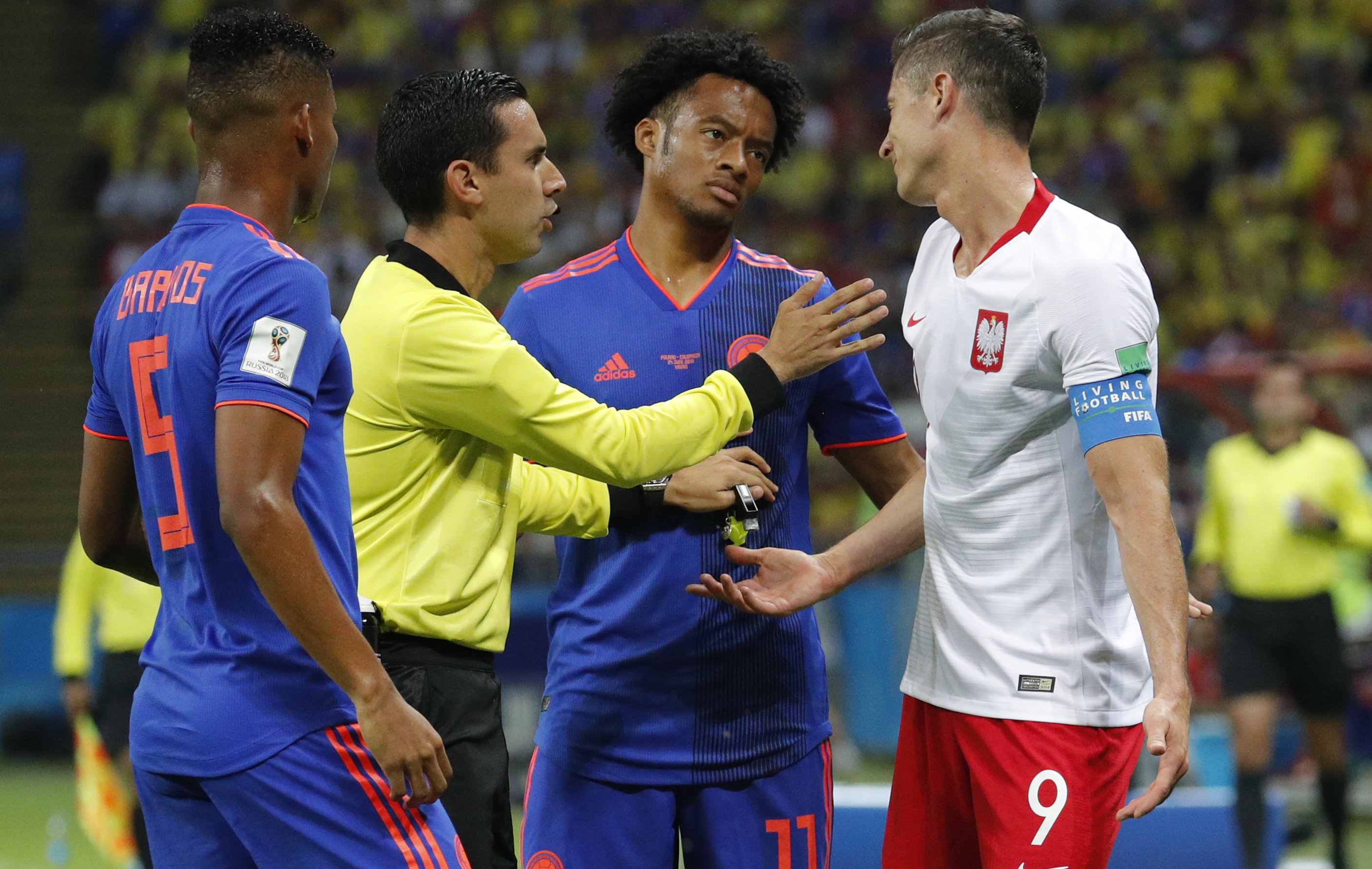 e6386f19013 ... Ramos talks to them during the FIFA World Cup 2018 group H preliminary  round soccer match between Poland and Colombia in Kazan