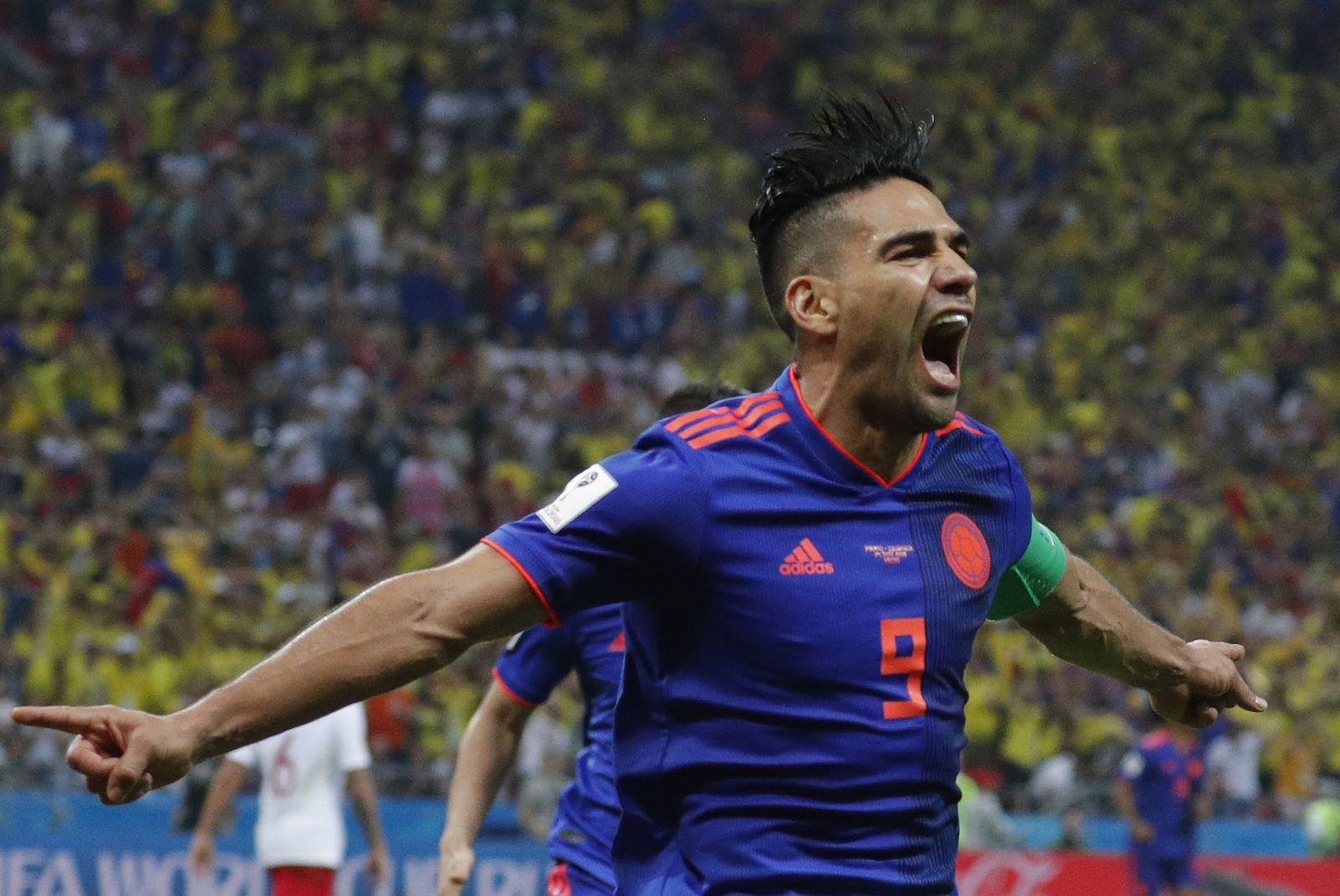 d8095ab49d1 By AFP• 24 June 2018. Radamel Falcao of Colombia celebrates after scoring  the 0-2 goal during the FIFA World Cup 2018 group H preliminary round  soccer match ...