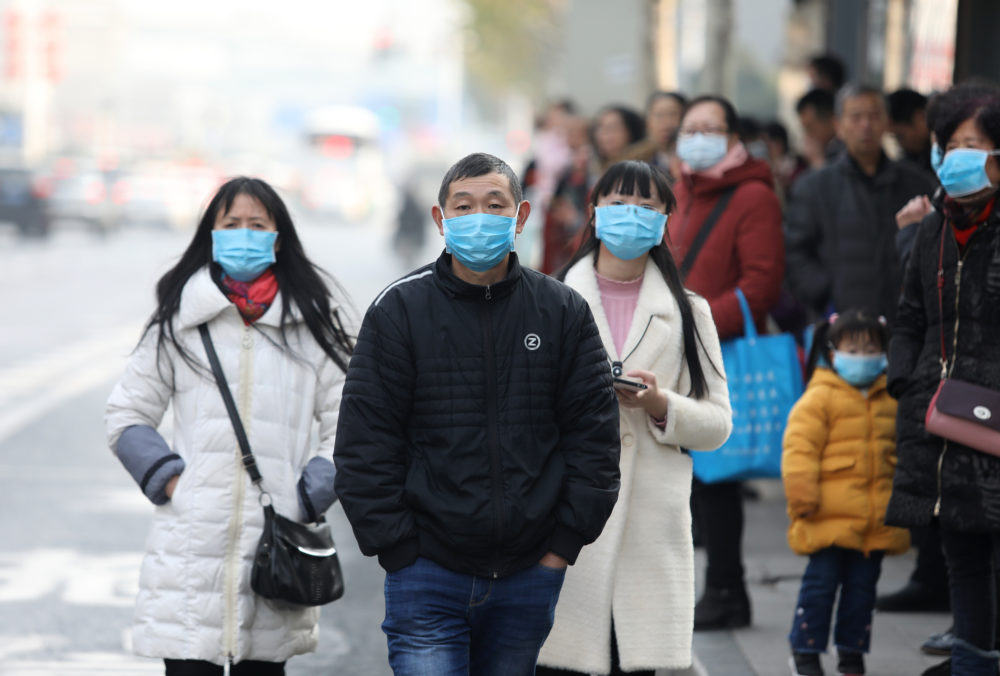 China confirms spread of new virus as cases surge