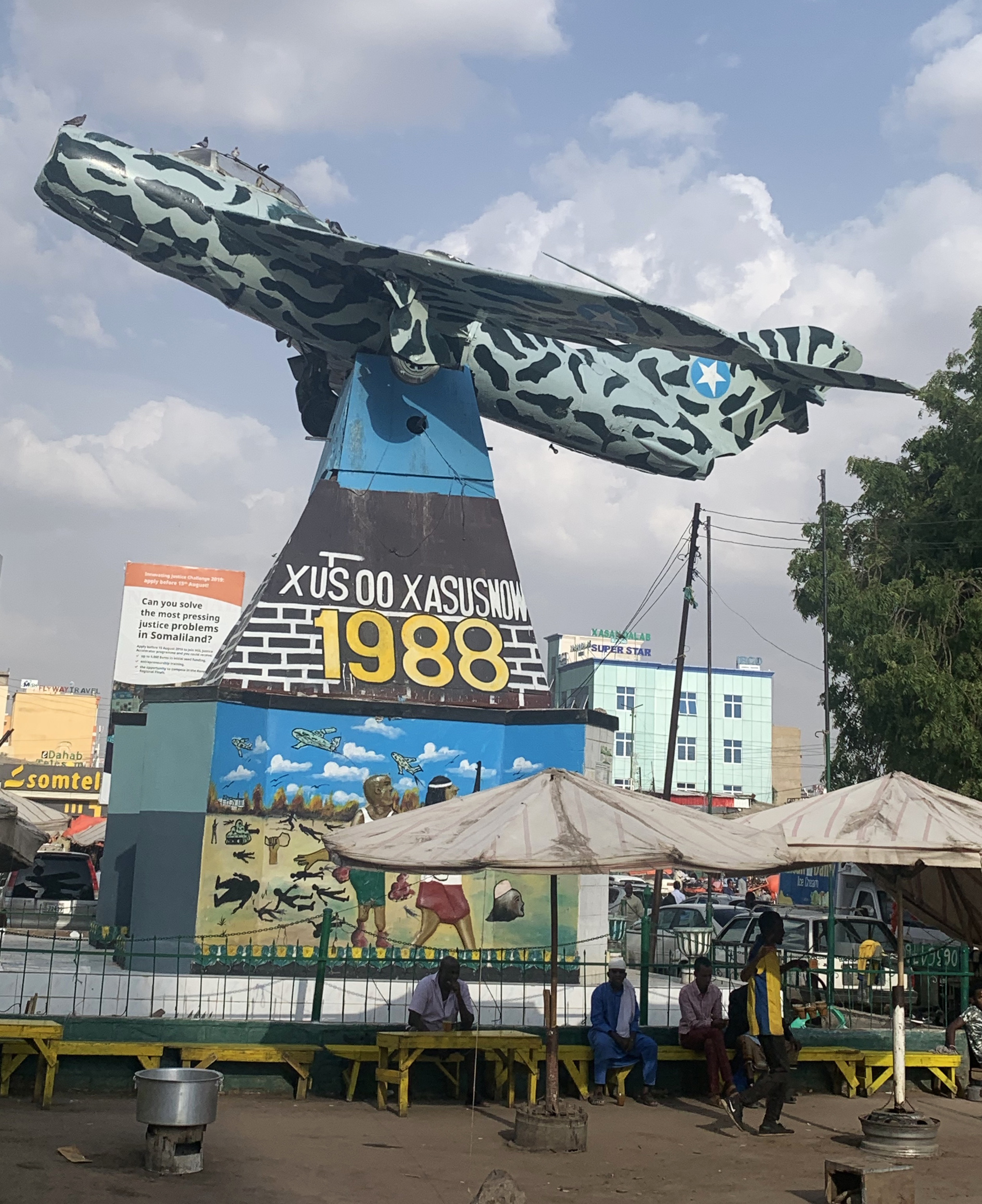 A Mig fighter on a plinth in downtown Hargeisa serves as a reminder of the bloody civil war. But these days it is the place where the growing army of unemployed youth hangs out to drink Somali tea. Photo: Ray Hartley